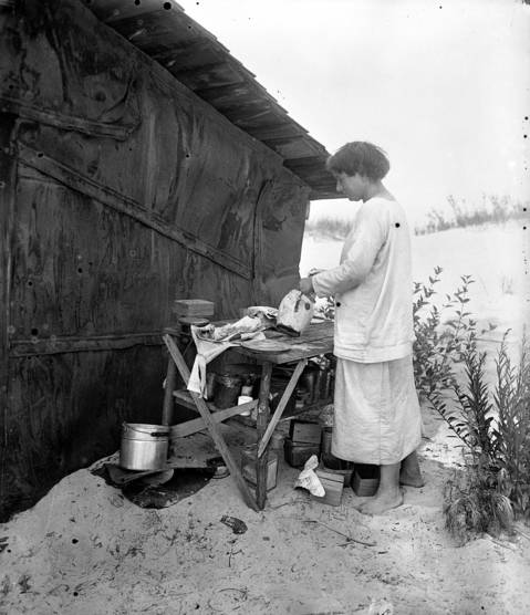 """Alice Gray at her shack she called """"Driftwood"""" at the Indiana Dunes. Gray told the Tribune that a fisherman had told her about the deserted sand-floored hut that she made into her home. Undated photo."""