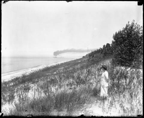 """Alice Gray at the Indiana Dunes where she lived for over nine years starting in 1915. In an interview with the Tribune in 1916 she had this to say: """"I was tired of working under the conditions and the lighting in offices, so I came out here. Then I wished never to go back to Chicago -- to the learned and the officious. Out in the dunes I wished to regain my poise once more and trust."""" Undated photo."""