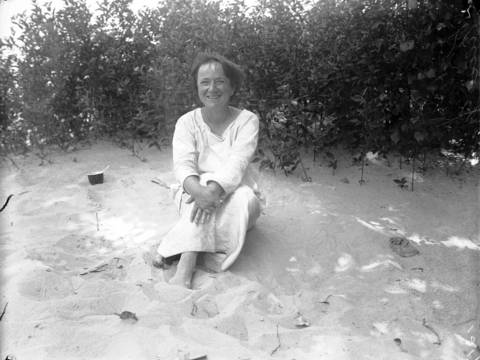 Alice Gray sits in the sand at the Indiana Dunes where she lived for over nine years in a shack, starting in 1915 until her death in 1925. Undated photo.