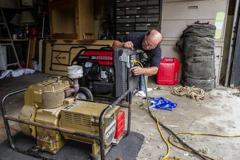 Sammy Verble, 62, uses portable generators to provide power for refrigerators and his neighbor's sump pumps in Midlothian.