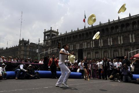 A circus worker performs as part of a protest against a law prohibiting the use of animals in circuses, in downtown Mexico City July 2, 2014. Mexico City's local government passed the law last month, sparking cries from circuses that the ban will spell ruin for their business. Circuses have one year to comply with the ruling.
