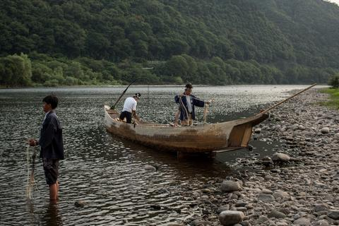 "Cormorant masters and boatmen prepare for the nights ""Ukai"" on July 2, 2014 in Gifu, Japan."