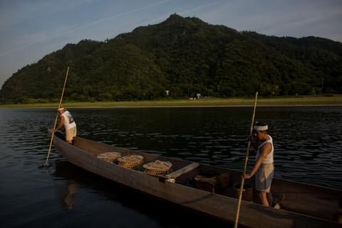 "Boatmen navigate up river to prepare for the nights ""Ukai"" on July 2, 2014 in Gifu, Japan."
