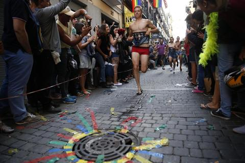 Contestants take part in the annual race on high heels during Gay Pride celebrations in the quarter of Chueca in Madrid July 3, 2014. The winner of the race receives a prize of 500 euros ($680), according to the organisers.