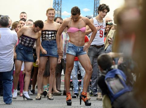 Participants take part in a high-heel race at a Gay Pride party in the central neighborhood of Chueca in Madrid on July 3, 2014.