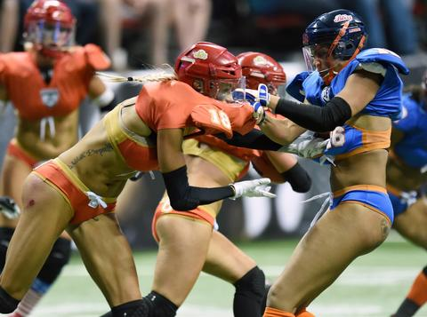 Chantell Taylor #16 of the Chicago Bliss grabs Cynthia Schmidt #18 of the Las Vegas Sin as Schmidt blocks for a runner during their game at the Thomas & Mack Center on July 3, 2014 in Las Vegas, Nevada. Chicago won 27-18.