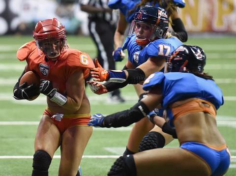 Markie Henderson #6 of the Las Vegas Sin gets away from Jori Parys #17 and Dominique Collins #12 of the Chicago Bliss to score a touchdown during their game at the Thomas & Mack Center on July 3, 2014 in Las Vegas, Nevada. Chicago won 27-18.