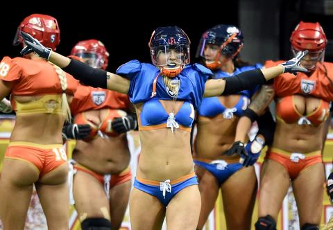 Alli Alberts #1 of the Chicago Bliss celebrates after scoring a touchdown against the Las Vegas Sin during their game at the Thomas & Mack Center on July 3, 2014 in Las Vegas, Nevada. Chicago won 27-18.