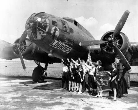 """A B-17 bomber purported to have been paid for with their war bonds is christened by children of Our Lady of Lourdes parochial school, located at Ashland and Leland Avenues in Chicago, in June 1944. According to the caption on this archive image, """"36 such planes have been bought by Chicago public and parochial school children."""""""