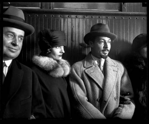 Rudolph Valentino (at right with goatee), his wife, second from left, and silent film actress Nita Naldi, far right, arrive in Chicago on their way to California in November 1925.