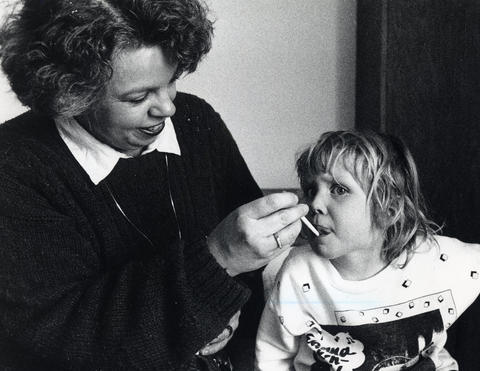 Feb. 15, 1989: Suzanne Canfield of Glendale Heights Community Hospital's new child care center checks three-year-old Stephanie's temperature.