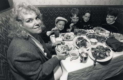 April 7, 1991: Pam Gallagher, a PADS administrative assistant and a surivor of homelessness, dines with sons Reed, Randy, Rory and Ryan during a free dinner at the Capriccio restaurant for residents of PADS.