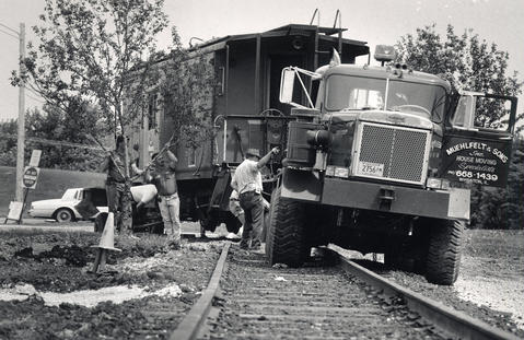 "May 15, 1991: Ron Muehlfelt, owner of Muehlfelt and Sons House Moving, directs his workers as they put a caboose in place at the ""Safety Village"" being built at the Glendale Heights Village Hall, 300 E. Fullerton Ave."