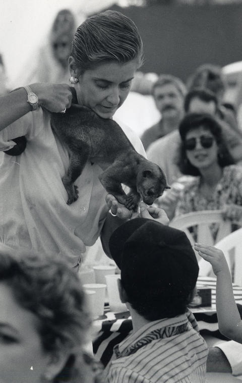 "Sept. 1, 1991: Naturalist Reute Butler shows kids in Glendale Heights a South American kinkajou as part of an event with Jim Fowler, the host of ""Mutual of Omaha's Wild Kingdom."""
