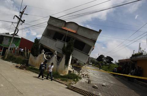 An earthquake-damaged house is pictured in the San Marcos region, in the northwest of Guatemala, July 7, 2014. A strong earthquake shook the Guatemalan border with Mexico on Monday, killing at least four people, damaging dozens of buildings and triggering landslides. The 6.9 magnitude quake struck near the frontier, and much of the damage was reported in the Guatemalan border region of San Marcos, where it downed power lines, opened cracks in buildings and triggered landslides which blocked roads.