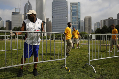Cleo Donaldson sets up barricades on Butler Field for the Taste of Chicago.