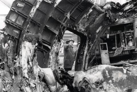 The interior of the United Airlines Flight 553, near the tail, is studied by fire officials after the crash.