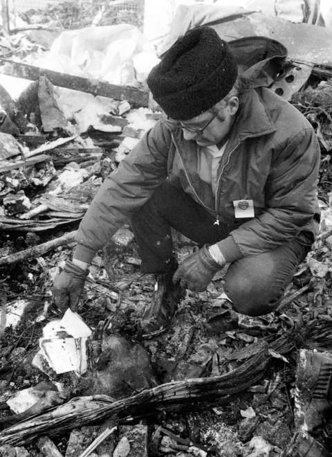 A postal inspector finds a piece of mail at the United Airlines crash site, two days after the crash.