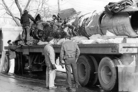 Workmen load parts of wreckage of United Airlines Flight 553 onto truck for removal to a hangar where federal investigators will try to determine the cause of the Dec. 8 crash.