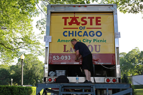 Brian Trousil of the Illinois Restaurant Assoication packs up after guarding a truckload of food at the Taste of Chicago grounds.