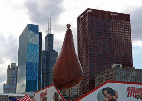 An oversized turkey leg statue stands in front of the skyline for the Taste of Chicago.
