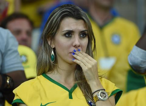 Brazilian supporters react after defeat in the semi-final football match between Brazil and Germany at The Mineirao Stadium in Belo Horizonte on July 8, 2014, during the 2014 FIFA World Cup.