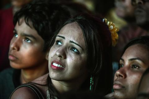 Brazil's fans react during a public viewing event at a street in Rio de Janeiro during the 2014 FIFA World Cup semifinal match Brazil vs Germany --being held at Mineirao Stadium in Belo Horizonte-- on July 8, 2014.