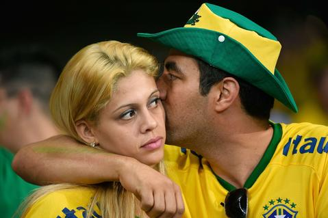 Fans of Brazil react during the semi-final football match between Brazil and Germany at The Mineirao Stadium in Belo Horizonte during the 2014 FIFA World Cup on July 8, 2014.
