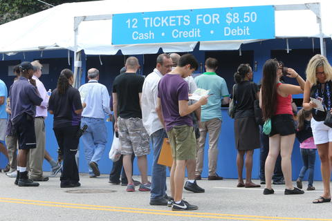 Visitors line up for food tickets on day one of the Taste of Chicago food festival in Grant Park.