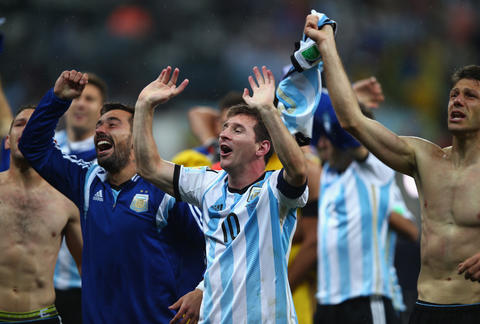 Lionel Messi celebrates after defeating the Netherlands.
