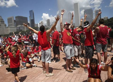 Fans enjoy spray from Buckingham Fountain.