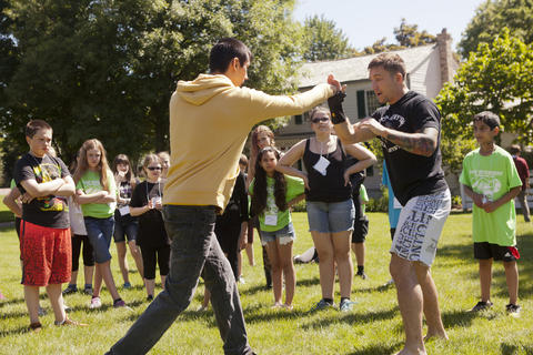 """June 13, 2014: Danny Aguirre, left, and Mike Corey, right, an MMA fighter and instructor demonstrate different punches during the martial arts class at Camp Divergent at Naper Settlement. The camp is a theme based on the """"Divergent"""" book series and is a collaboration between Naper Settlement and Anderson's Bookshop."""