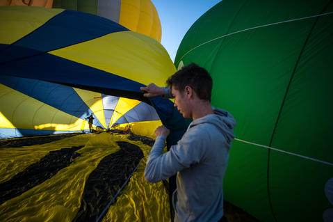 A hot air balloon is inflated at the European Balloon Festival on July 10, 2014 in Igualada, Spain. The early morning flight of over 30 balloons was shorter than expected due to windy weather. This flight is organised as a curtain raiser for the four-day European Balloon Festival. Now is the 18th year of the most important hot air Balloon event in Spain and one of the biggest in Europe.