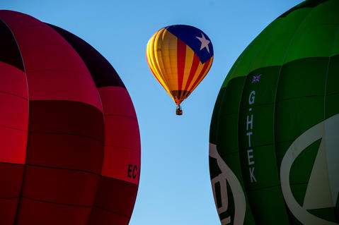 A hot air balloon with a Catalan pro-independence flag flies over Igualada during an early flight as part of the European Balloon Festival on July 10, 2014 in Igualada, Spain. The early morning flight of over 30 balloons was shorter than expected due to windy weather. This flight is organised as a curtain raiser for the four-day European Balloon Festival. Now is the 18th year of the most important hot air Balloon event in Spain and one of the biggest in Europe.