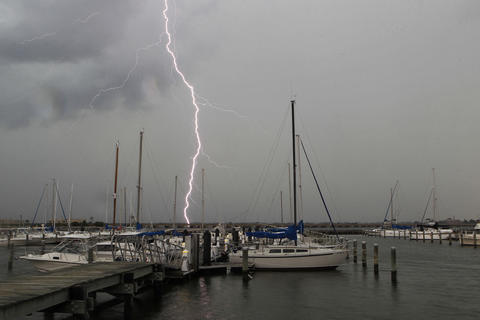 Staff Photo Of The Week: July 5-July 11, 2014 Lightning strikes off in the distance as a storm moves over Old Point Comfort Marina on Fort Monroe Wednesday afternoon.