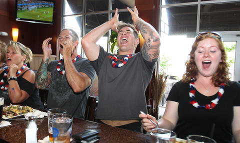 Staff Photo Of The Week: June 28-July 4, 2014 Josh Hays, Anthony Bider and Erin Miller react as the United States soccer team almost scores in the first period of their game against Belgium Tuesday at the Cove Tavern.