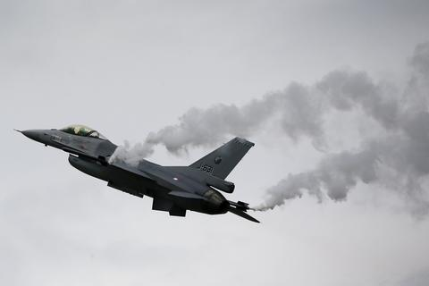 A General Dynamics F-16M Fighting Falcon of the Royal Netherlands Air Force performs during The Royal International Air Tattoo at the RAF in Fairford July 11, 2014.