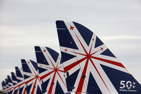 The tails of The Royal Air Force aerobatic team, the Red Arrows, are seen during The Royal International Air Tattoo at the RAF in Fairford July 11, 2014.