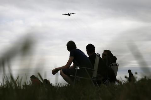 Aviation enthusiasts attend the The Royal International Air Tattoo at the RAF in Fairford July 11, 2014.