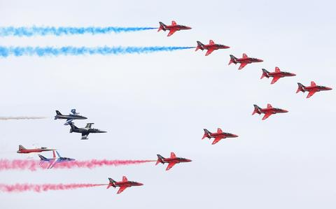 The RAF Red Arrows Display team fly in formation at the Royal International Air Tattoo at RAF Fairford on July 11, 2014 in Fairford, England.
