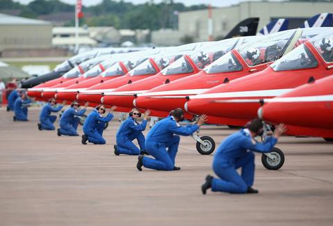The RAF Red Arrows Display team prepare to leave their stand at the Royal International Air Tattoo at RAF Fairford on July 11, 2014 in Fairford, England.