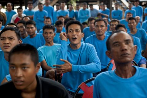Inmates react during a Muay Thai fight at Klong Pai prison on July 12, 2014 in Nakhon Ratchasima, Thailand. Prison Fight is an sport event which takes place in different prisons in Thailand and involves inmates fighting against foreign fighters looking for their rehabilitation, to promote the sport and good health among prisoners and to help them with better social adaptation for the future. Thailand has a strong tradition in fight sports such as Muay Thai and boxing, and inmates can reduce their jail sentence fighting in this event organized between World Prison Fight Association (WPFA) with the assistance of the Department Of Corrections.