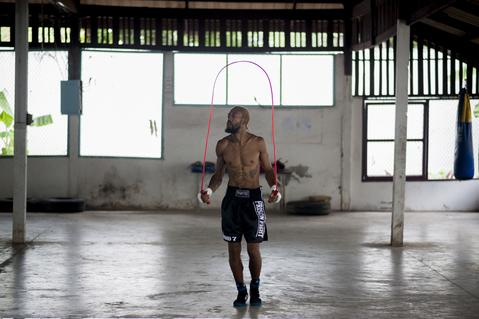 NAKHON RATCHASIMA, THAILAND - JULY 12: A foreign fighter jumps rope before his fight at Klong Pai prison on July 12, 2014 in Nakhon Ratchasima, Thailand. Prison Fight is an sport event which takes place in different prisons in Thailand and involves inmates fighting against foreign fighters looking for their rehabilitation, to promote the sport and good health among prisoners and to help them with better social adaptation for the future. Thailand has a strong tradition in fight sports such as Muay Thai and boxing, and inmates can reduce their jail sentence fighting in this event organized between World Prison Fight Association (WPFA) with the assistance of the Department Of Corrections. (Photo by Borja Sanchez-Trillo/Getty Images) ORG XMIT: 501626985