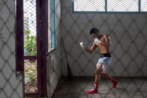 An inmate prepares himself before his fight at Klong Pai prison on July 12, 2014 in Nakhon Ratchasima, Thailand. Prison Fight is an sport event which takes place in different prisons in Thailand and involves inmates fighting against foreign fighters looking for their rehabilitation, to promote the sport and good health among prisoners and to help them with better social adaptation for the future. Thailand has a strong tradition in fight sports such as Muay Thai and boxing, and inmates can reduce their jail sentence fighting in this event organized between World Prison Fight Association (WPFA) with the assistance of the Department Of Corrections.