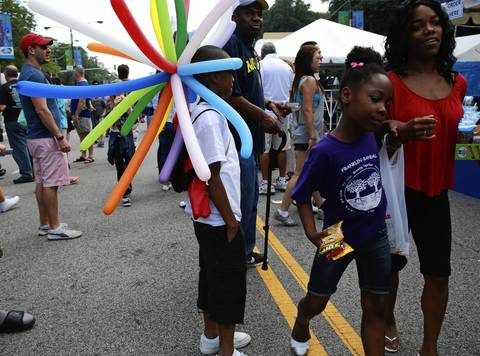 Shaquille Harvison, 9, wears a hat of balloons at the Taste of Chicago.
