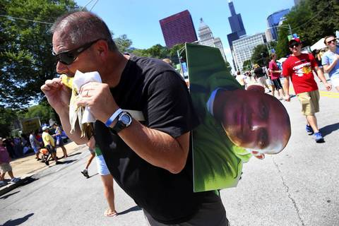 Steve Przymierski, a sheriff from Toledo Ohio who is at Taste with a bunch of other sheriffs, carries his buddy Jason Stambaugh along with him because Jason wasn't able to make it to Chicago.