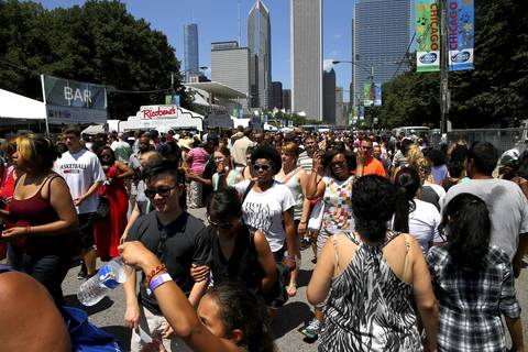 Crowds came out early to Taste of Chicago after the festival reopened following a day long shut down due to heavy rains.