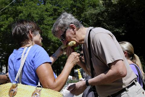 Irene Bauer feeds her husband Bob some of her corn at Taste of Chicago. They recently moved to LaGrange from Phoenix.