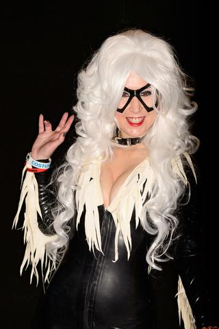 A woman dressed as the character Black Cat from The Amazing Spider-Man comics and films at the London Film and Comic Con 2014 in Earls Court, west London, on July 13, 2014. The event lets enthusiasts purchase rare items before getting the chance to meet film stars, TV actors, wrestlers and other personalities in the signing and photo zones. AFP PHOTO / LEON NEALLEON NEAL/AFP/Getty Images ORG XMIT: