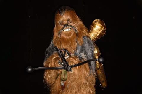 "A person dressed as ""Chewbacca"" from the Star Wars films poses at the London Film and Comic Con 2014 in Earls Court, west London, on July 13, 2014. The event lets enthusiasts purchase rare items before getting the chance to meet film stars, TV actors, wrestlers and other personalities in the signing and photo zones. AFP PHOTO / LEON NEALLEON NEAL/AFP/Getty Images ORG XMIT:"
